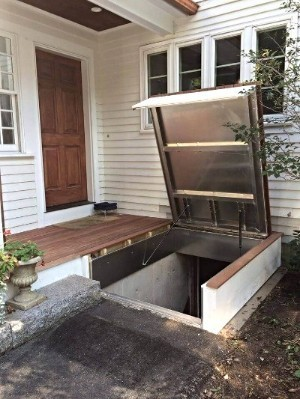LuciGold all aluminum cellar door hidden under wooden porch