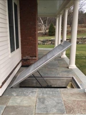 LuciGold all aluminum flat hatch under stone patio